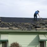 Collingwood roofers removing old shingles to prepare a roof for a new installation